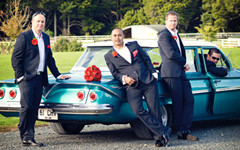 Groom and Groomsmen posing on wedding car